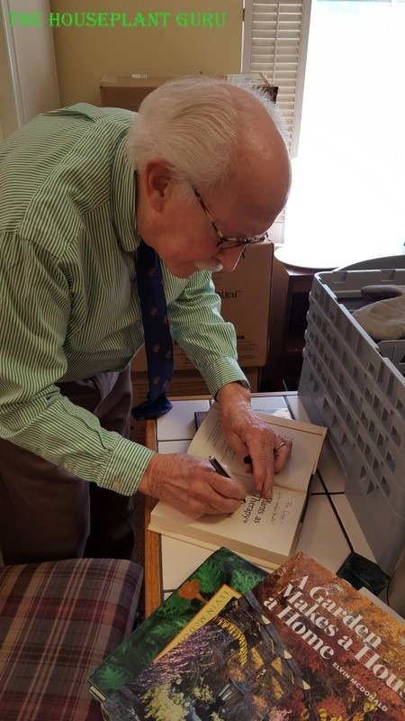 Graciously signing my many books!